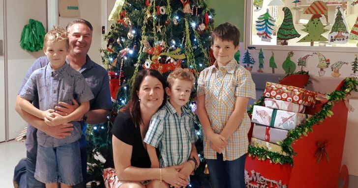 Tracy morgan owner of squoodles nz and her family in front of christmas tree