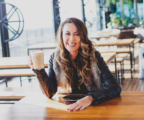 nz female entrepreneur drinking coffee in cafe